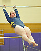 Sarah Woods of Massapequa performs on the uneven bars during a Nassau County varsity gymnastics meet against Plainview JFK at McKenna Elementary School on Monday, Feb. 1, 2016.