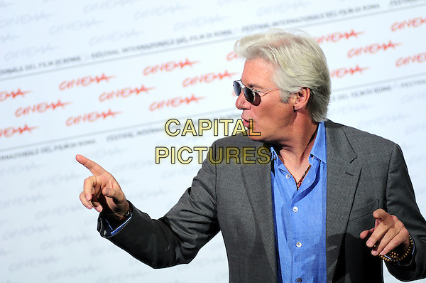 RICHARD GERE.The 'Hachico: A Dog's Story' photocall during day 2 of the 4th Rome International Film Festival, Auditorium Parco della Musica, Rome, Italy..October 16th, 2009.half length grey gray suit jacket blue shirt sunglasses shades mouth open hand finger pointing .CAP/CAV.©Luca Cavallari/Capital Pictures.