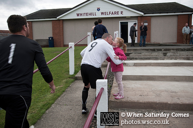 Whitehill Welfare 4 Gala Fairydean Rovers 2, 10/08/2013. Ferguson Park, Scottish Lowland Football League. Gala Fairydean Rovers centre-forward greets daughter at the conclusion of his team's inaugural match in the Scottish Lowland Football League away to Whitehill Welfare at Ferguson Park. Gala were formed in 2013 by an a re-amalgamation of Gala Fairydean and Gala Rovers, the two clubs having separated in 1908 and Gala's Netherdale ground in Galashiels in the Scottish Borders had one of only two stands designated as listed football stands in Scotland. Whitehill won the match, the first-ever in the newly-formed Lowland League by 4 goals to 2. Photo by Colin McPherson.