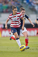 February 9, 2013:  USA Women's National Team midfielder Carli Lloyd (10) pushes the ball up field during action between the USA Women's National Team and Scotland at EverBank Field in Jacksonville, Florida.  USA defeated Scotland 4-1............
