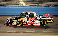 Nov. 13, 2009; Avondale, AZ, USA; NASCAR Camping World Truck Series driver Todd Bodine during the Lucas Oil 150 at Phoenix International Raceway. Mandatory Credit: Mark J. Rebilas-