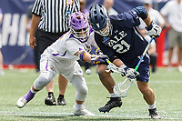 Conor Mackie  (#21) battles TD Ierlan (#3) in a faceoff as Yale defeats UAlbany 20-11 in the NCAAA semifinal game at Gillette Stadium, May 26.