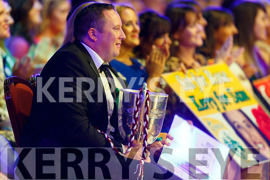 The Neilus Flynn Hurling Championship Cup supporting 2019 Kerry Rose, Causeway's Sally Ann Leahy on stage with Daithi O'Se at the Dome on Tuesday night.