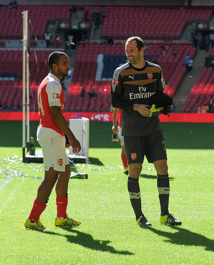 Arsenal's Petr Cech celebrates with Theo Walcott after their 1-0 win over Chelsea<br /> <br /> Photographer Ashley Western/CameraSport<br /> <br /> Football - FA Community Shield - Arsenal v Chelsea - Sunday 2nd August 2015 - Wembley Stadium - London<br /> <br /> &copy; CameraSport - 43 Linden Ave. Countesthorpe. Leicester. England. LE8 5PG - Tel: +44 (0) 116 277 4147 - admin@camerasport.com - www.camerasport.com