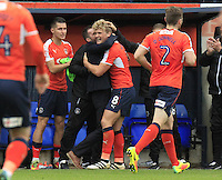 Cameron McGeehan of Luton Town celebrates his equalizing goal with manager Nathan Jones  during the Sky Bet League 2 match between Luton Town and Mansfield Town at Kenilworth Road, Luton, England on 22 October 2016. Photo by Liam Smith.