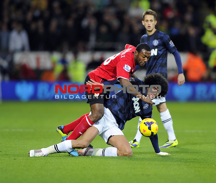 Cardiff City Midfielder, Kevin Theophile Catherine (FRA) is fouled by Man Utd Midfielder Marouane Fellaini (BEL)   SPORT - FOOTBALL - Cardiff City Stadium - Cardiff City v Manchester United - Barclays Premier League.<br /> Foto nph / Meredith<br /> <br /> ***** OUT OF UK *****