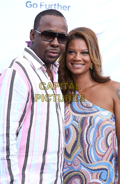 Bobby Brown & guest.2012 Hoodie Awards at the Grand Garden Arena inside MGM Grand Resort and Casino, Las Vegas, Nevada, USA..August 4th, 2012.half length black white pink shirt goatee facial hair sunglasses shades one shoulder dress .CAP/ADM/MJT.© MJT/AdMedia/Capital Pictures.
