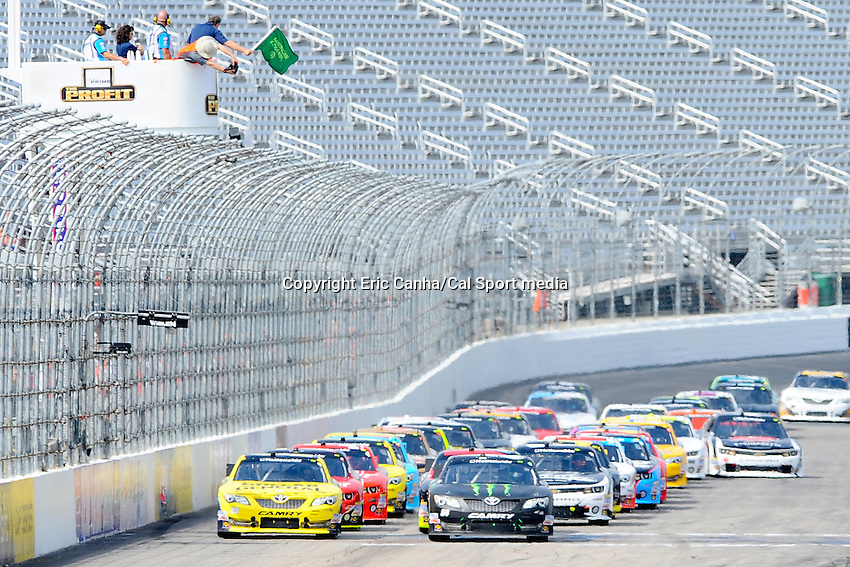 """July 13, 2013 - Loudon, New Hampshire U.S. - The green flag drops to start racing in the NASCAR Nationwide Series CNBC Prime's """"The Profit"""" 200 race being held at the New Hampshire Motor Speedway in Loudon, New Hampshire.   Eric Canha/CSM"""