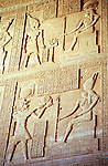 Ancient hieroglyphics adorn the walls of the temple at Dendera, Egypt