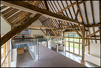 BNPS.co.uk (01202 558833)<br /> Pic: Strutt&amp;Parker/BNPS<br /> <br /> Old meets new - the 400 year old oak beams frame the modern open plan interior.<br /> <br /> These stark before and after pictures show the remarkable transformation of a dilapidated barn into a luxurious home worth &pound;1.25million. <br /> <br /> The ramshackle 16th century structure on a derelict farm was in a state of near ruin before developer Mark Parmenter undertook the colossal project - his first ever barn conversion. <br /> <br /> Mr Parmenter, 60, identified the magnificent 400-year-old beams as the centrepiece of his project. <br /> <br /> Despite the decrepit exterior, which pictures show to have been rusty and crumbling, he was pleasantly surprised to find the inside in remarkably good condition. <br /> <br /> The property is now on the market with Strutt &amp; Parker.