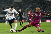 Erik Lamela of Tottenham Hotspur and Vincent Kompany of Manchester City during Tottenham Hotspur vs Manchester City, Premier League Football at Wembley Stadium on 14th April 2018