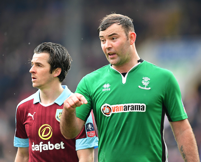 Burnley's Joey Barton, left, and Lincoln City's Matt Rhead<br /> <br /> Photographer Chris Vaughan/CameraSport<br /> <br /> Emirates FA Cup Fifth Round - Burnley v Lincoln City - Saturday 18th February 2017 - Turf Moor - Burnley <br />  <br /> World Copyright &copy; 2017 CameraSport. All rights reserved. 43 Linden Ave. Countesthorpe. Leicester. England. LE8 5PG - Tel: +44 (0) 116 277 4147 - admin@camerasport.com - www.camerasport.com