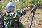 Cambodian Deminer Testing Metal Detector