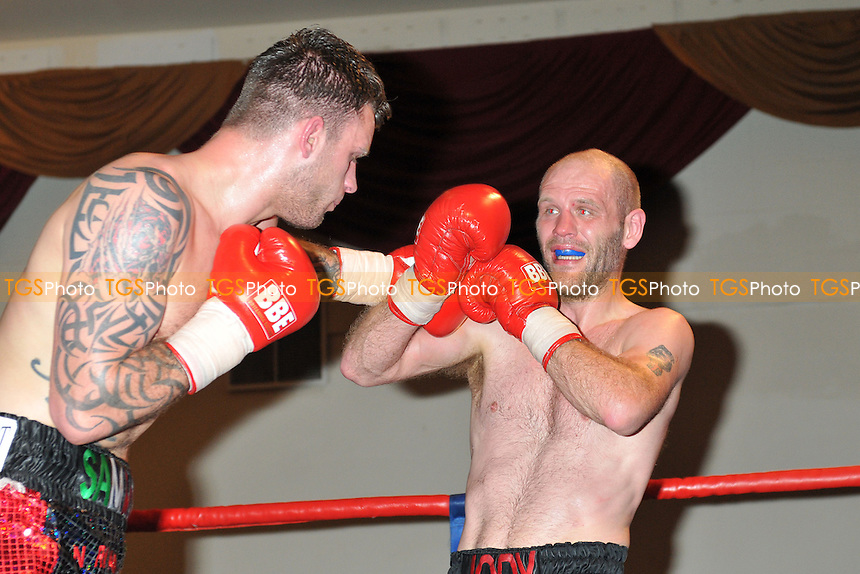 Sam Couzens (green/black shorts) defeats Jody Meikle in a Super-Middleweight boxing contest at the Civic Hall, Grays, Essex, promoted by Carl Greaves - 15/03/14 - MANDATORY CREDIT: Philip Sharkey/TGSPHOTO - Self billing applies where appropriate - 0845 094 6026 - contact@tgsphoto.co.uk - NO UNPAID USE