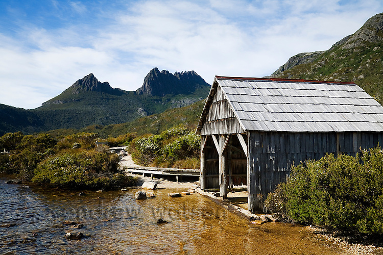 Boat shed at Dove Lake, with Cradle Mountain beyond.  Cradle Mountain-Lake St Clair National Park, Tasmania, AUSTRALIA