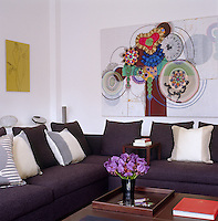 'Orchid' by Gary Hume and a painting by Beatriz Milhazes decorate one corner of the living room
