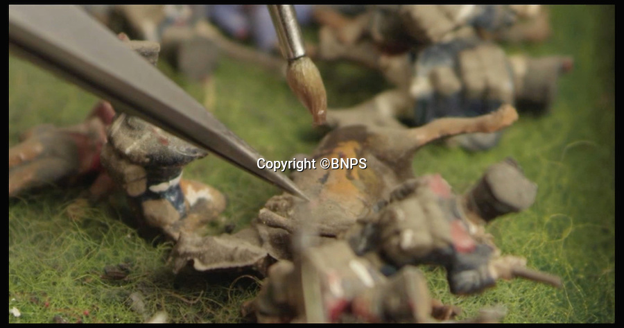 BNPS.co.uk (01202 558833)<br /> Pic: PhilYeomans/BNPS<br /> <br /> Stills from the video: varnishing the pieces.<br /> <br /> Historic battle brought back to life...<br /> <br /> A stunning diorama of the battle of Waterloo has been restored to its former glory after a painstaking cleaning operation to remove nearly 50 years of dust.<br /> <br /> The sweeping panorama contain's 21,500 figures and nearly 10,000 horses, each of which has been meticulously cleaned by hand over the last five months by husband and wife team Kelvin and Mary Thatcher from Norfolk.<br /> <br /> The pristine model has now gone back on display at the refurbished Royal Green jackets museum in Winchester.<br /> <br /> A sobering fact is that there were over twice as many casualties in the actual battle as there are figures on the diorama.