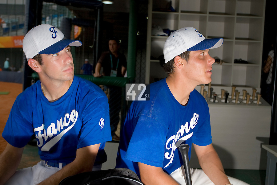 20 August 2007: Pierrick Lemestre (left) and Boris Marche (right) listen to one of the coaches prior to the Czech Republic 6-1 victory over France in the Good Luck Beijing International baseball tournament (olympic test event) at the Wukesong Baseball Field in Beijing, China.