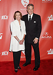 LOS ANGELES, CA - FEBRUARY 10: Minority Leader of the United States House of Representatives Nancy Pelosi (L) and husband Paul Pelosi attend MusiCares Person of the Year honoring Tom Petty at the Los Angeles Convention Center on February 10, 2017 in Los Angeles, California.