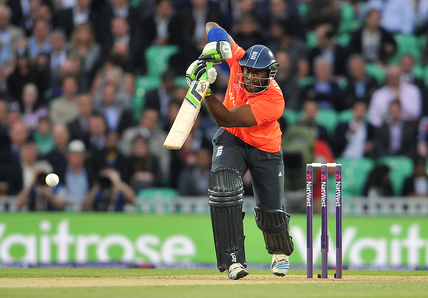 England's Michael Carberry drives during his innings of 7<br /> <br /> Photographer Ashley Western/CameraSport<br /> <br /> International Cricket - 2014 NatWest International T20 - England v Sri Lanka - Tuesday 20th May 2014 - The Kia Oval - London<br /> <br /> &copy; CameraSport - 43 Linden Ave. Countesthorpe. Leicester. England. LE8 5PG - Tel: +44 (0) 116 277 4147 - admin@camerasport.com - www.camerasport.com