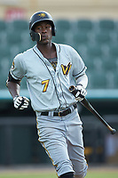 Oneil Cruz (7) of the West Virginia Power heads back to the dugout after lining out against the Kannapolis Intimidators at Kannapolis Intimidators Stadium on July 25, 2018 in Kannapolis, North Carolina. The Intimidators defeated the Power 6-2 in 8 innings in game one of a double-header. (Brian Westerholt/Four Seam Images)