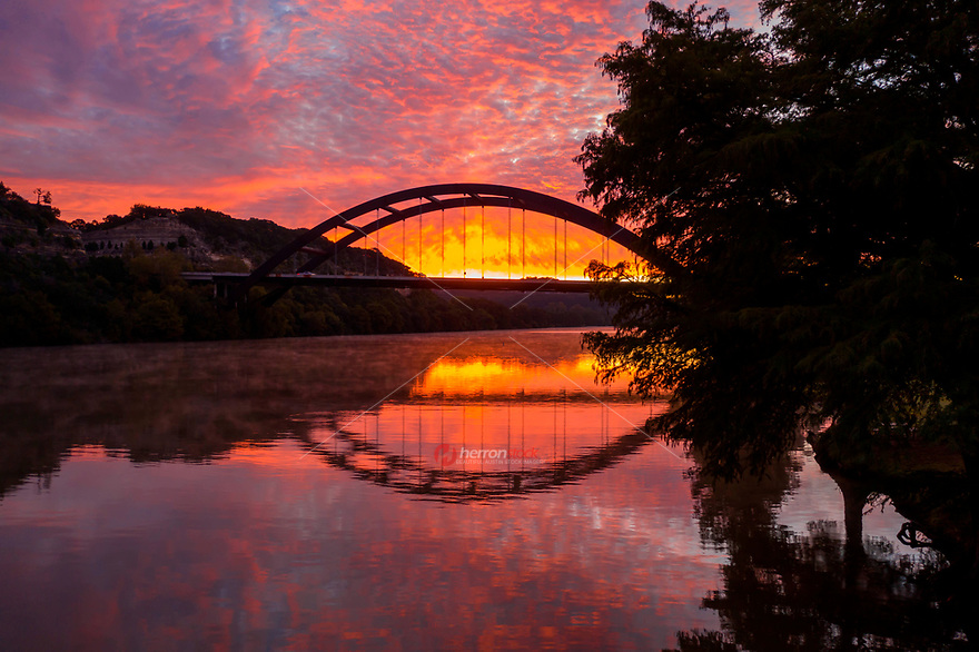 Wow, this freezing cold morning I found an insanely beautiful sunrise overlooking the Austin 360 Bridge (otherwise known as Pennybacker Bridge) as the steam rose up from Lake Austin on this gorgeous morning.