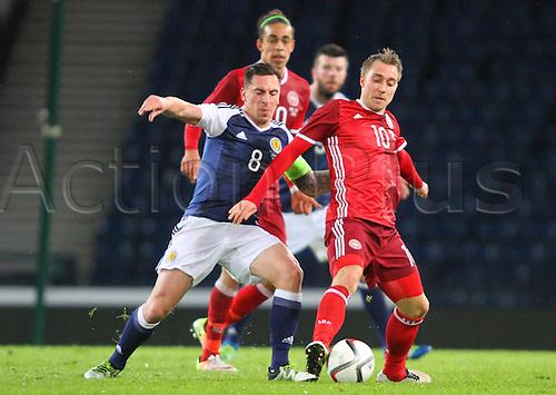 29.03.2016. Hampden Park, Glasgow, Scotland. International Football Friendly Scotland versus Denmark.  Scott Brown and Christian Eriksen battle for the ball