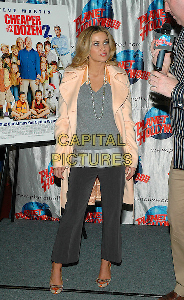 "CARMEN ELECTRA.Promotes her new film, ""Cheaper By The Dozen 2"" at Planet Hollywood in Times Square in New York City. .December 19th, 2005.Photo: Patti Ouderkirk/AdMedia/Capital Pictures.Ref: PO/ADM.full length grey gray top pearl necklace peach coat microphone interview cropped trousers.www.capitalpictures.com.sales@capitalpictures.com.© Capital Pictures."