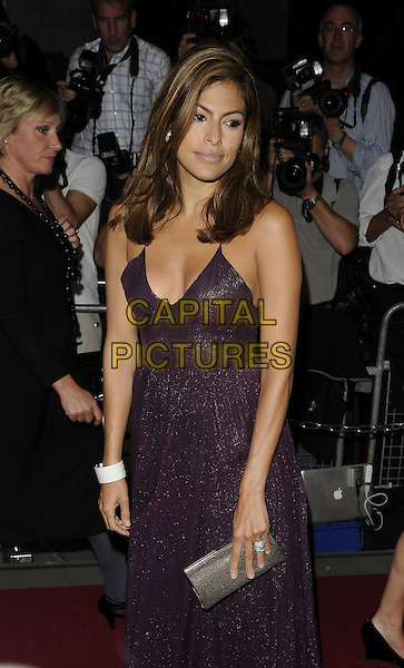 EVA MENDES.The GQ Men Of The Year Awards 2009 held at the Royal Opera House, Covent Garden, London, England. .8th September 2009 .half 3/4 length purple aubergine mendes dress silver grey gray clutch bag white bracelet .CAP/CAN.©Can Nguyen/Capital Pictures.