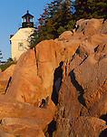 Acadia National Park, ME:  Bass Harbor Head Lighthouse (1858) in sunrise light above the rocky point of Mount Desert Island