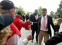 The Ohio State Buckeyes each take a buckeye and shake hands with fans and ushers as they enter Ohio Stadium to take on Kent State in Columbus, Saturday morning, September 13, 2014. (Dispatch Photo by Jenna Watson)