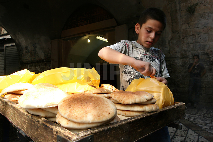 Portrait of Ahmed, a 10 year-old Palestinian boy who works in one of the markets in east Jerusalem's old city. July 3, 2008 . .Photo by : Tess Scheflan/ JINI.