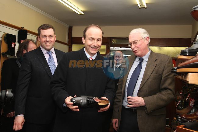 Micheál Martin and Thomas Byrne canvassing in Kells, pictured here with Jim Kiernan in his Shoe shop...(Photo credit should read Jenny Matthews www.newsfile.ie)....This Picture has been sent you under the conditions enclosed by:.Newsfile Ltd..The Studio,.Millmount Abbey,.Drogheda,.Co Meath..Ireland..Tel: +353(0)41-9871240.Fax: +353(0)41-9871260.GSM: +353(0)86-2500958.email: pictures@newsfile.ie.www.newsfile.ie.