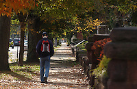 Student Strolling down Whitney Avenue Sidewalk with Autumn Colors, New Haven Connecticut