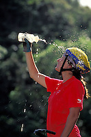 Hawaii, Oahu, woman mountain biker cooling off with water bottle.  MR available.