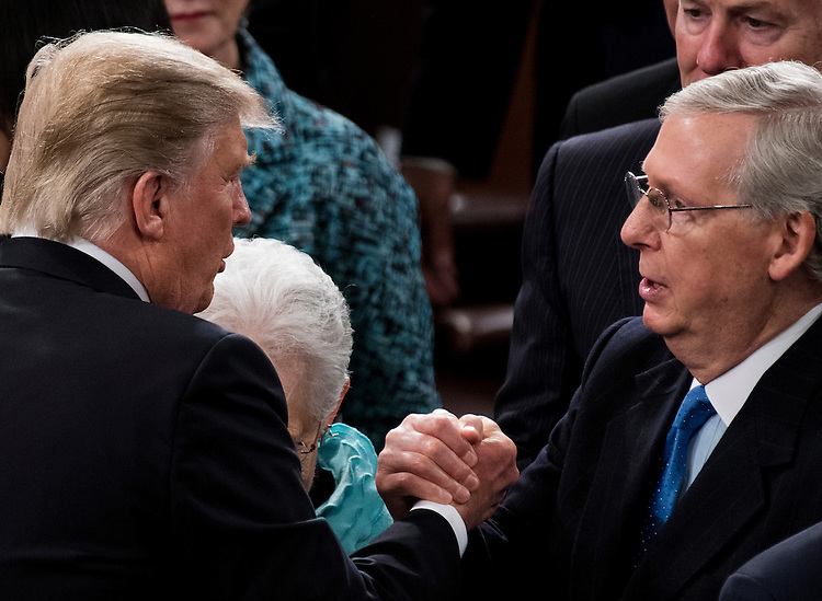 UNITED STATES - FEBRUARY 28: President Donald Trump shakes hands with Senate Majority Leader Mitch McConnell, R-Ky., after delivering his address to a joint session of Congress on Tuesday, Feb. 28, 2017. (Photo By Bill Clark/CQ Roll Call)