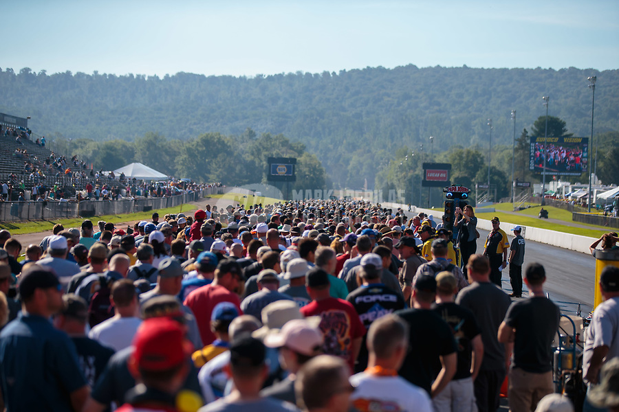 Sep 16, 2018; Mohnton, PA, USA; NHRA fans walk on the track during the track walk prior to the Dodge Nationals at Maple Grove Raceway. Mandatory Credit: Mark J. Rebilas-USA TODAY Sports