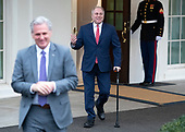 Incoming United States House Minority Whip Steve Scalise (Republican of Louisiana) walks out of the West Wing to meet reporters at the White House after meeting with US President Donald J. Trump on border security and reopening the federal government at the White House in Washington, DC on Wednesday, January 2, 2018.  Incoming US House Minority Leader Kevin McCarthy (Republican of California) is in the foreground at left.<br /> Credit: Ron Sachs / CNP