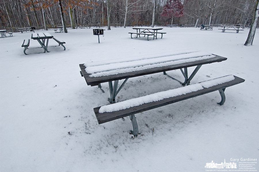 An overnight snow settles on picnic tables in a city park near Westerville, Ohio.<br />