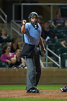Umpire Carlos Torres makes a call during an Arizona Fall League game between the Scottsdale Scorpions and Salt River Rafters on October 13, 2015 at Salt River Fields at Talking Stick in Scottsdale, Arizona.  Salt River defeated Scottsdale 5-3.  (Mike Janes/Four Seam Images)
