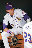 LSU Tigers outfielder Mark Laird (9) relaxes in the dugout before the NCAA College World Series game against the TCU Horned Frogs on June 14, 2015 at TD Ameritrade Park in Omaha, Nebraska. TCU defeated LSU 10-3. (Andrew Woolley/Four Seam Images)