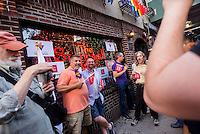 New York, NY 26 June 2015 - Lesbian and Gay families, advocates, and supporters gathered outside the Stonewall In, in Greenwich Village, to celebrate the Supreme Court decision that same-sex marriage is constitutional. Lesbian and Gay couples lined up to be photographed outside the landmarked Stonewall Inn