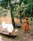 PERU, Amazon Rainforest, South America, Latin America, tribal man standing by boat