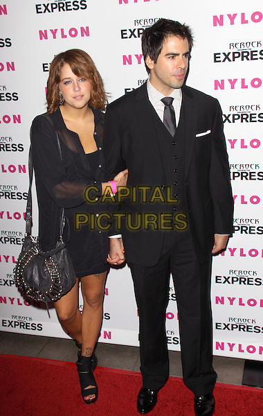 PEACHES GELDOF & ELI ROTH .at the NYLON + EXPRESS August Denim Issue party held at The London in West Hollywood, California, USA, August 10th 2010.s.full length couple black suit tie sheer see thru through shirt bag dress skirt holding hands .CAP/RKE/DVS.©DVS/RockinExposures/Capital Pictures.