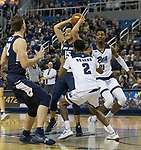 Utah State forward Abel Porter (15) caloks to pass the ball against Nevada in the second half of an NCAA college basketball game in Reno, Nev.,  Wednesday, Jan. 2, 2019. (AP Photo/Tom R. Smedes)