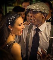 Jelly Germain (tap dancer) and Caroline Podetti dancing during a Paris Boogie Speakeasy soirée hosted by Yves Riquet for members of Cambridge University and others at 256 Rue Marcadet, Paris. Paris Boogie Speakeasy is a private jazz and cocktail club founded, run and owned by Yves Riquet. Judged by l'Express as being one of the top ten most exciting private locations in Paris, Paris Boogie Speakeasy has created the artistic and intellectual euphoria of the inter war années folles, with New Orleans, Boogie Woogie, Charleston and Blues music from that era, speakeasy cocktails and a scintillating range of musicians, dancers and guests. Friday 12th December 2014.