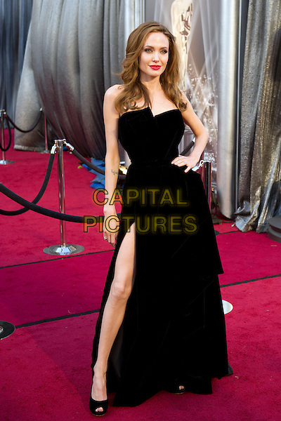 Angelina Jolie.Arrivals at the 84th Annual Academy Awards® in Hollywood, CA., USA..February 26, 2012.*Editorial Use Only*.oscars full length black strapless dress  slit split hand on hip .CAP/A.M.P.A.S./NFS.©A.M.P.A.S. Supplied by Capital Pictures.