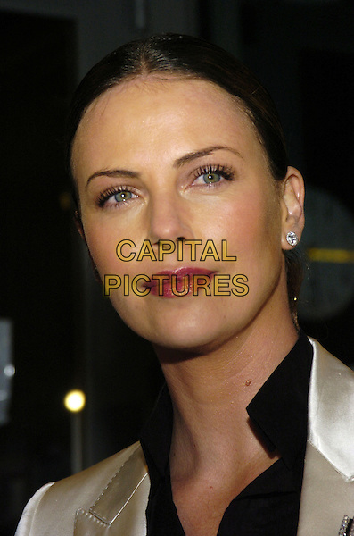 """CHARLIZE THERON.Premiere of """"East of Havana"""" at IFC Center, New York, New York, USA..February 1st, 2007.headshot portrait pink lipstick diamond earrings .CAP/ADM/BL.©Bill Lyons/AdMedia/Capital Pictures *** Local Caption ***"""