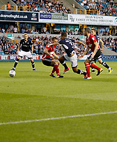 Millwall's James Meredith is felled during the Sky Bet Championship match between Millwall and Ipswich Town at The Den, London, England on 15 August 2017. Photo by Carlton Myrie.