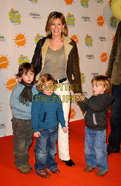 "ANDREA CATHERWOOD & KIDS.At the ""Spongebob Squarepants - The Sponge who could Fly"" Gala performance at the Hammersmith Apollo, London, England. .March 5th 2009 .full length sheepskin fur jacket cream brown white jeans denim children black blue holding hands .CAP/CAN.©Can Nguyen/Capital Pictures."